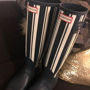 Tall nay and white hunter rain boots.